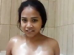 North indian housewife rinsing